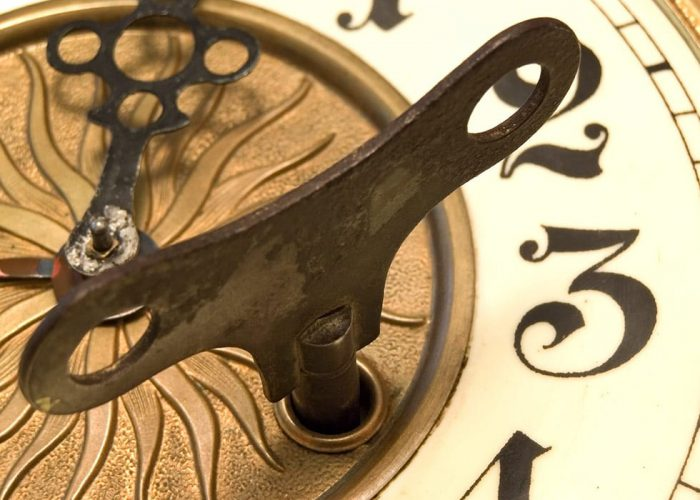 Old Fashioned Close Up Clock With The Key